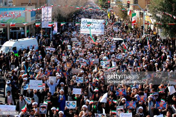 Progovernment demonstrators march in Iran's holy city of Qom some 130 kilometres south of Tehran on January 3 as tens of thousands gathered across...