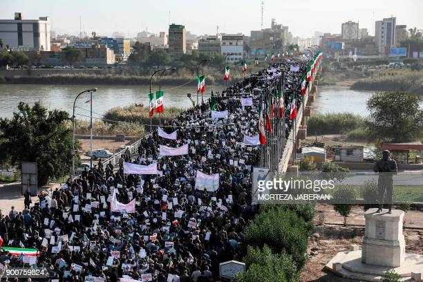 Progovernment demonstrators march in Iran's southwestern city of Ahvaz on January 3 as tens of thousands gathered across Iran in a massive show of...