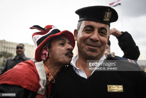 A progovernment Egyptian man kisses a policeman on Cairo's landmark Tahrir Square on January 25 as the country marks the fifth anniversary of the...