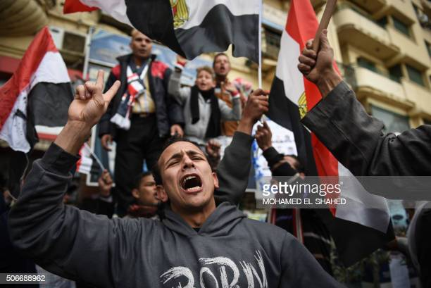 Progovernment Egyptians holding national flags gather on Cairo's landmark Tahrir Square on January 25 as the country marks the fifth anniversary of...