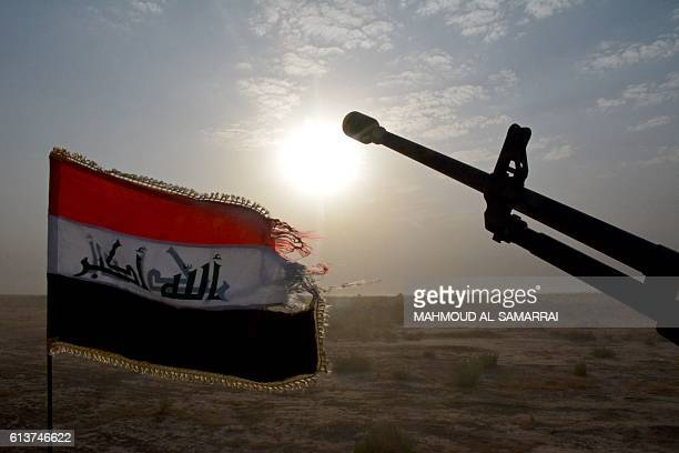 A progovernment forces military vehicle bearing the Iraqi flag is seen in Iraq's eastern Salaheddin province south of Hawijah on October 10 as...