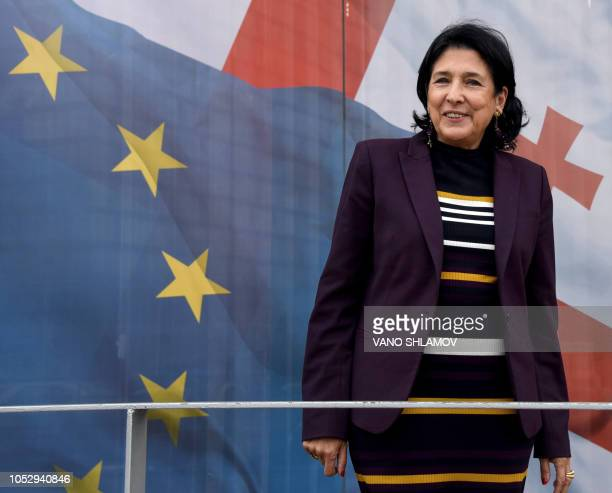 Progovernment presidential candidate Salome Zurabishvili poses outside her campaign office ahead of October 28 elections in Tbilisi on October 24 2018