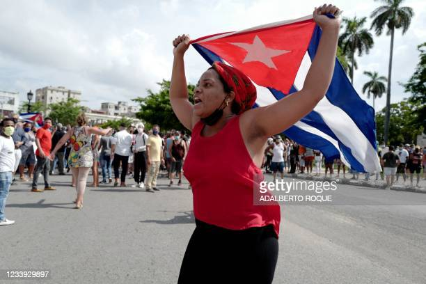 Pro-government woman is seen during a demonstration against the government of Cuban President Miguel Diaz-Canel in Havana, on July 11, 2021. -...