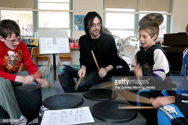 A program for ADHD kids with Mark Lucas drummer from the band Radiators teaching kids with the practice pads and sticks 23 August 2006 SMH Picture by...