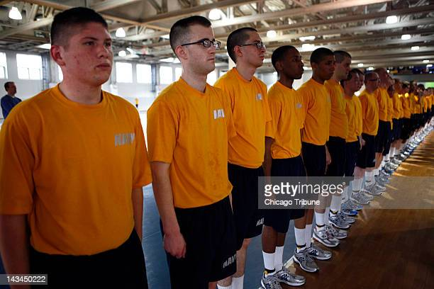 FIT program recruit Mason Hawks second from left stands at attention after successfully completing a timed mile and a half run on April 11 at Naval...