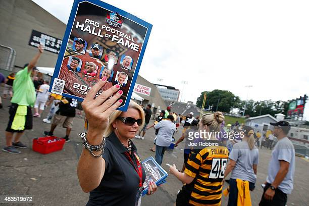 A program vendor is seen as fans make their way to the NFL Hall of Fame Game between the Pittsburgh Steelers and Minnesota Vikings at Tom Benson Hall...