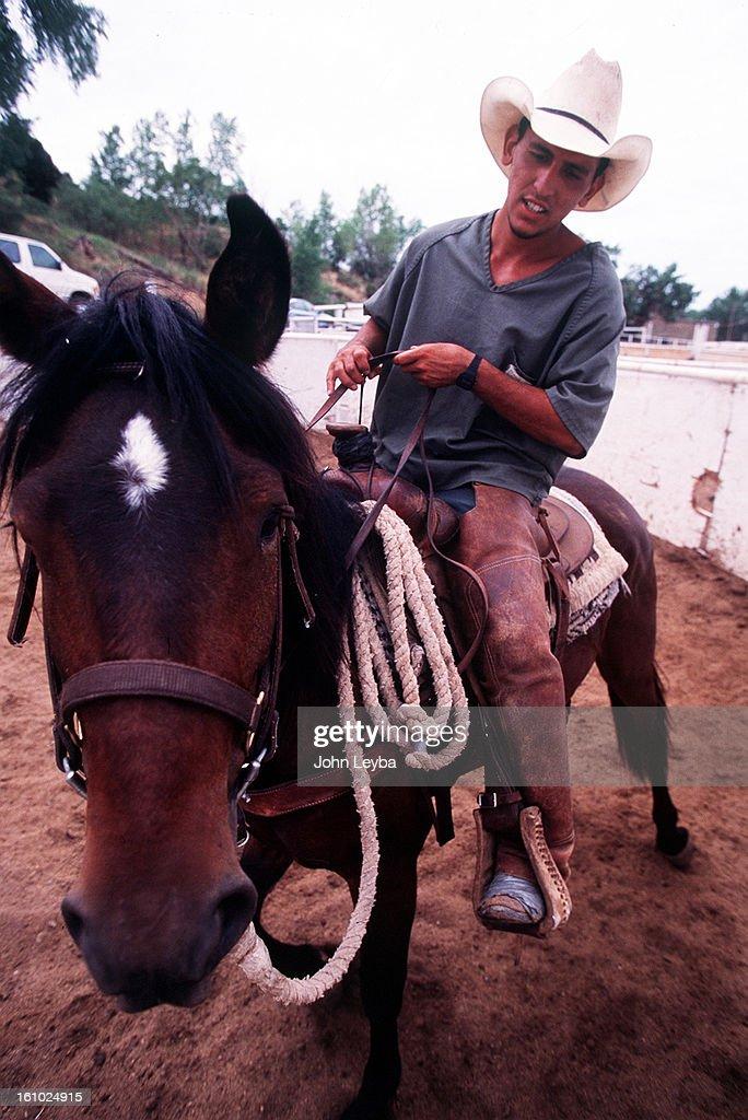 PROGRAM--Inmate Lonnie Aragon Rides A Horse In A Pen