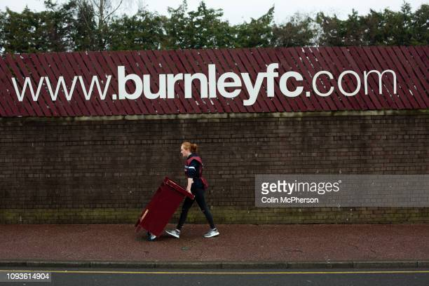 Programme seller on Harry Potts Way outside the stadium before Burnley hosted Everton in an English Premier League fixture at Turf Moor. Founded in...