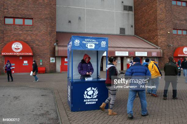 A programme seller outside Pittodrie Stadium before the match