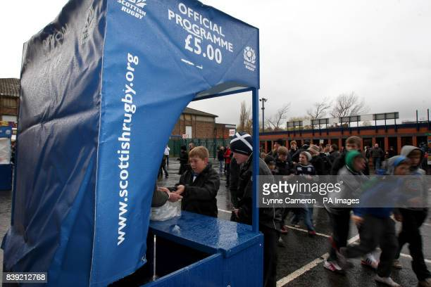 Programme sellers outside Murrayfield before the match