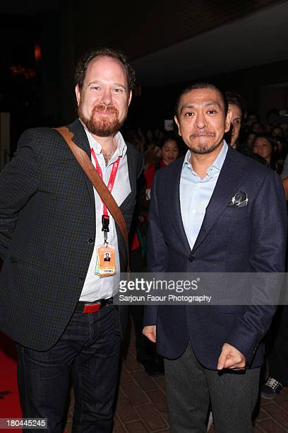 "Programmer Collin Geddes and Director Hitoshi Matsumoto arrive at the ""R100"" premiere during the 2013 Toronto International Film Festival at Ryerson..."