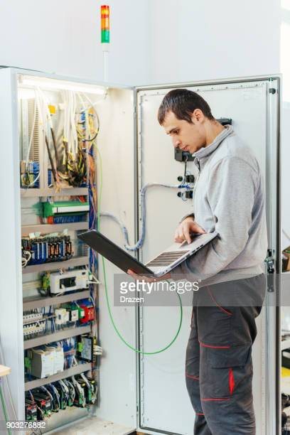 Programmer is checking the quality of software in charge of automation