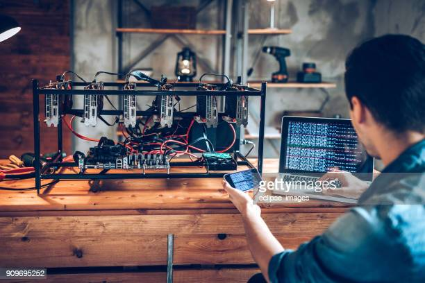 programmer preparing mining rig with gpu - cryptocurrency mining stock pictures, royalty-free photos & images