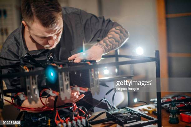 Programmer preparing mining rig with GPU