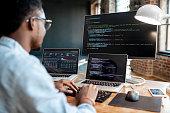 Programmer working with program code