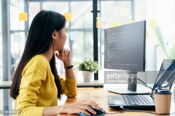 programmers and developer teams are coding and developing softwa - desktop pc stock pictures, royalty-free photos & images