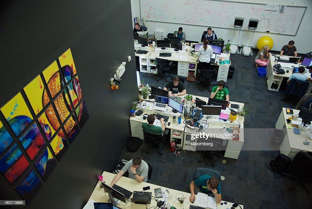Programmers work at desks inside the Clearpath Robotics Inc. headquarters in Kitchener, Ontario, Canada, on Friday, July 24, 2015. Clearpath Robotics, Inc. manufactures industrial robot research and development applications in addition to offering guidance, navigation, control, perception, military engineers, educational mobile robots, hardware components, and computer scientists. Photographer: James MacDonald/Bloomberg via Getty Images