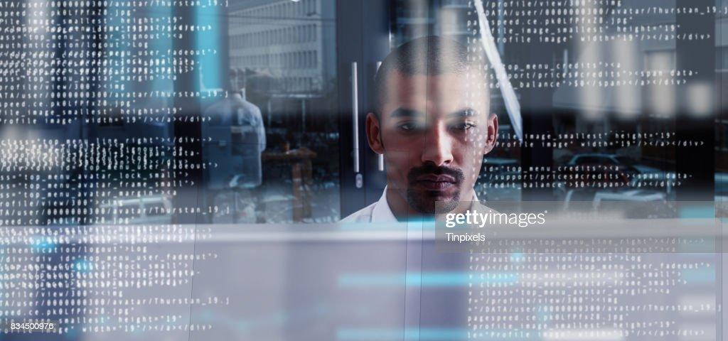 Programming like the pro that he is : Stock Photo