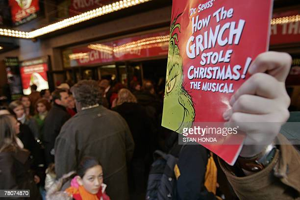 Programs are sold outside 'Dr Seuss' How the Grinch Stole Christmas The Musical' 23 November 2007 at the St James Theatre in New York A New York...
