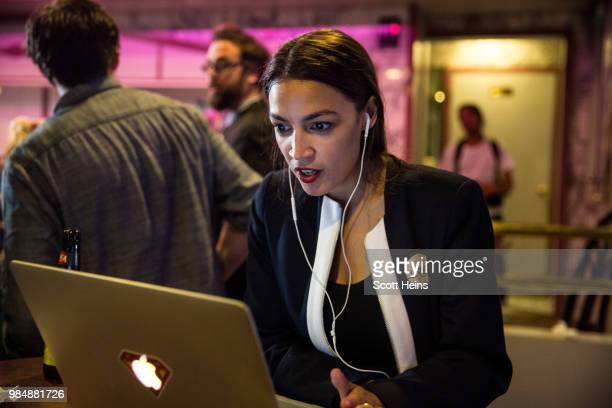Progressive challenger Alexandria OcasioCortez celebrartes at a victory party in the Bronx after upsetting incumbent Democratic Representative Joseph...