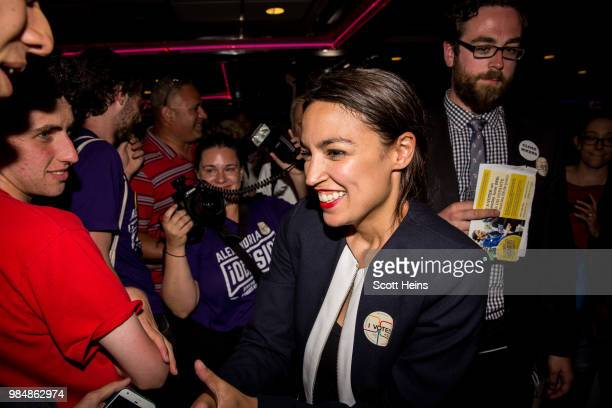 Progressive challenger Alexandria OcasioCortez celebrartes with supporters at a victory party in the Bronx after upsetting incumbent Democratic...