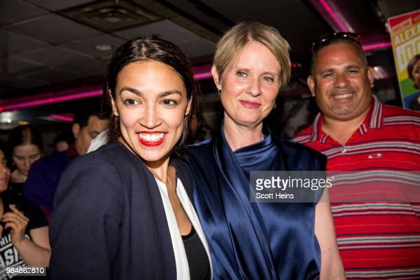 Progressive challenger Alexandria OcasioCortez is joined by New York gubenatorial candidate Cynthia Nixon at her victory party in the Bronx after...