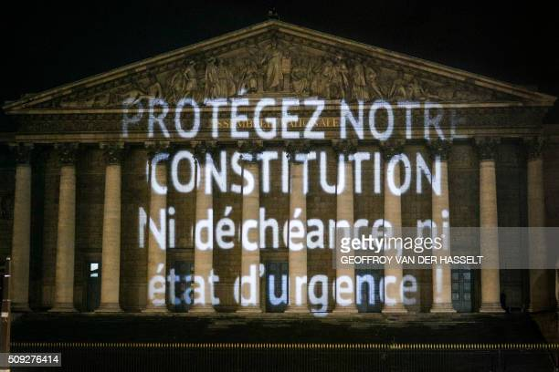 A progressive citizen's movement projects a message on the wall of the Palais Bourbon French national assembly on February 9 to deputies who will...