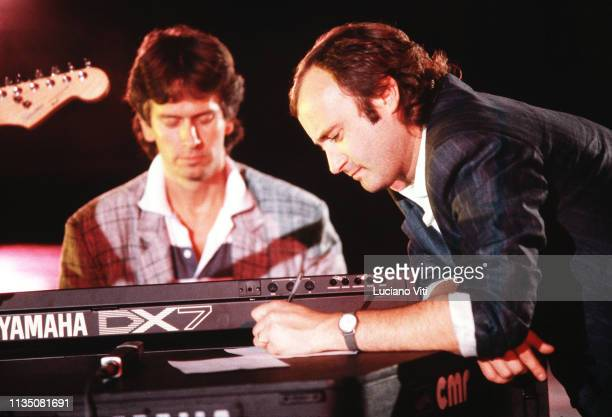 Progressive rock band Genesis Tony Banks and Phil Collins on stage Rome Italy 1985 Banks has a Yamaha DX7 keyboard