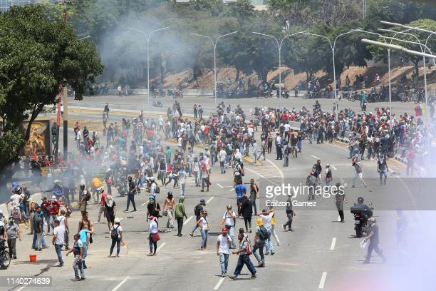 ProGuaidó demonstrators gather near La Carlota air force on April 30 2019 in Caracas Venezuela Through a live broadcast via social media Venezuelan...