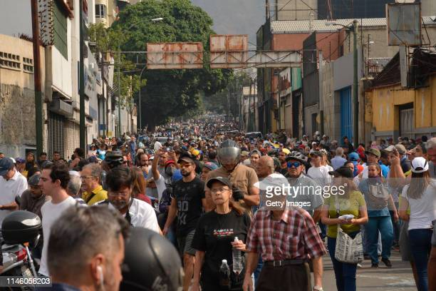ProGuaidó demonstrators gather outside the air force base La Carlota on April 30 2019 in Caracas Venezuela Through a live broadcast via social media...
