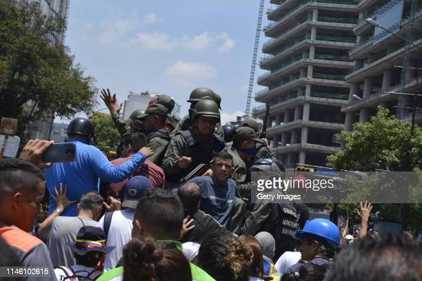 ProGuaidó military officers join supporters on April 30 2019 in Caracas Venezuela Through a live broadcast via social media Venezuelan opposition...