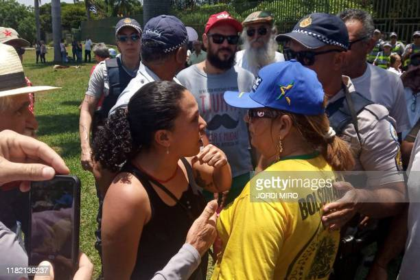 Pro-Guaido and Maduro supporters argue in front of the Venezuelan embassy in Brasilia, Brazil, on November 13 while loyalists to Venezuelan...