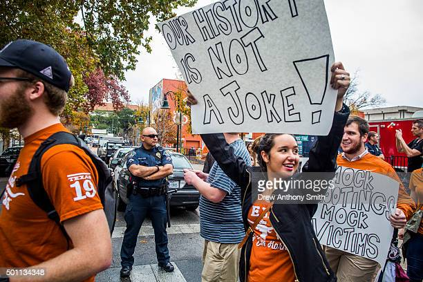 Progun control protestors rally against an open carry demonstration close to The University of Texas campus December 12 2015 in Austin Texas In...