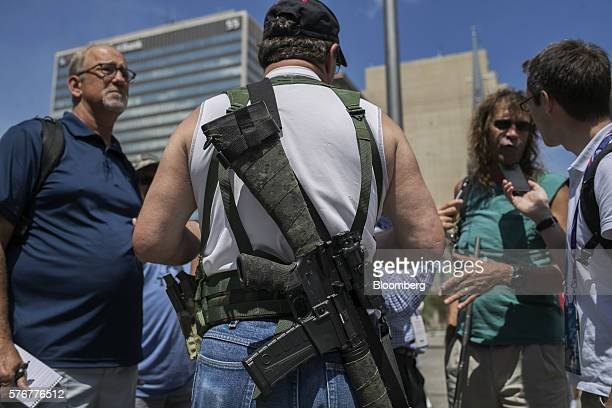 A progun protester speaks with members of the media at the Public Square ahead of the the Republican National Convention in Cleveland Ohio US on...