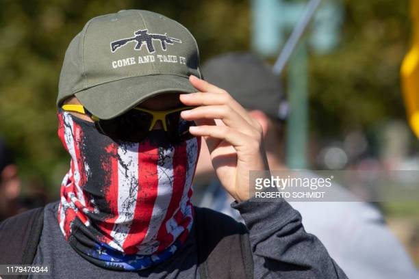 A progun supporter attends a rally in favor of the 2nd Amendment in front of the US Capitol on November 2 in Washington DC The 2nd Amendment to the...