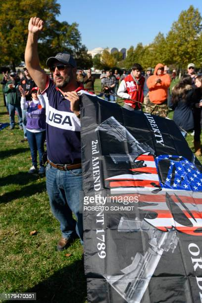 A progun supporter cheers during a rally in favor of the 2nd Amendment in front of the US Capitol on November 2 in Washington DC The 2nd Amendment to...