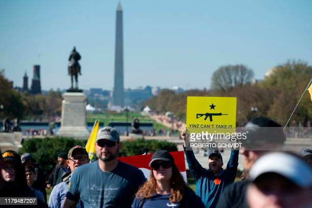 A progun supporter shouts during a rally in favor of the 2nd Amendment in front of the US Capitol on November 2 in Washington DC The 2nd Amendment to...