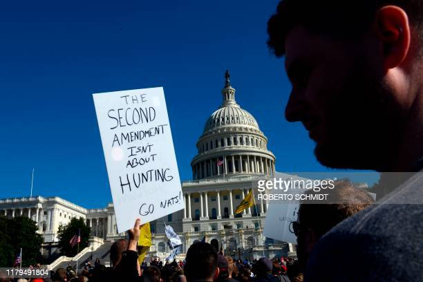 Progun supporters attend a rally in favor of the 2nd Amendment in front of the US Capitol on November 2 in Washington DC The 2nd Amendment to the US...