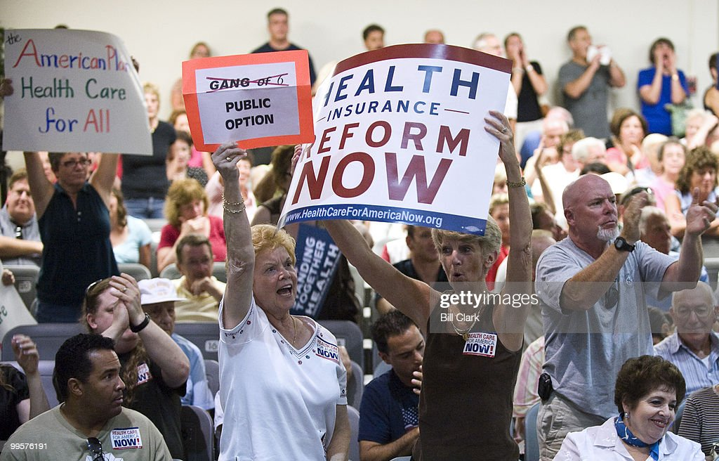 Pro-healthcare reform attendees cheer during Rep. Frank Pallone's town hall meeting at Red Bank Middle School in Red Bank, N.j., on Tuesday evening, Aug. 25, 2009.