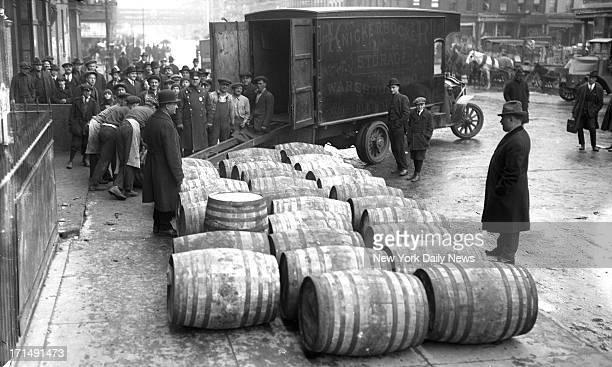 Prohibition agents confiscate barrels of wine on the streets of New York City