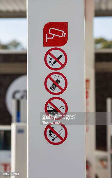 Prohibition signs forbidding smoking use of cell phones running motors and open fire at a multienergy filling station of the oil company Total on...