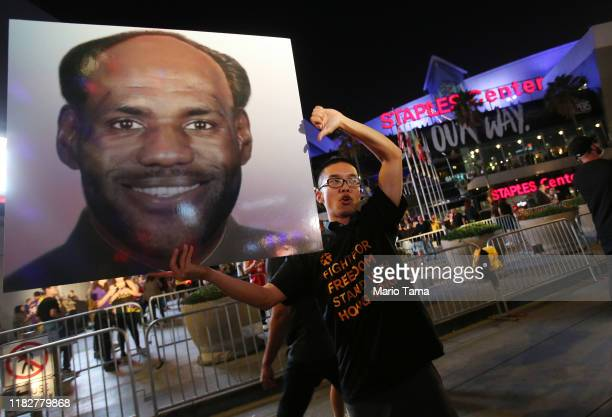 A proHong Kong activist holds a photo depicting LeBron James as Chinese communist revolutionary Chairman Mao Zedong before the Los Angeles Lakers...