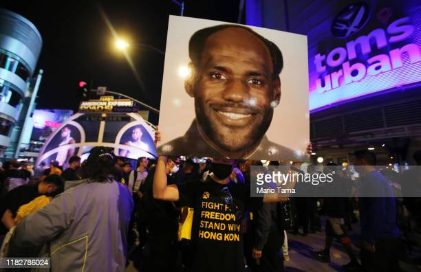 A proHong Kong activist holds an image depicting LeBron James as Chinese communist revolutionary Chairman Mao Zedong before the Los Angeles Lakers...