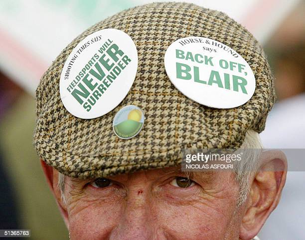 A prohunt supporter wears buttons on his hat on the Brighton Pier to protest the Labour Party Conference in Brighton England 28 September 2004 The...