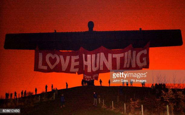 Prohunting campaigners hang a huge banner from the Angel of the North Britain's largest sculpture as an early Valentine's message to their sport *...