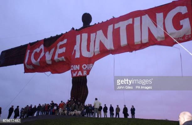 Prohunting campaigners stand under a huge banner hung from the Angel of the North Britain's largest sculpture as an early Valentine's message to...