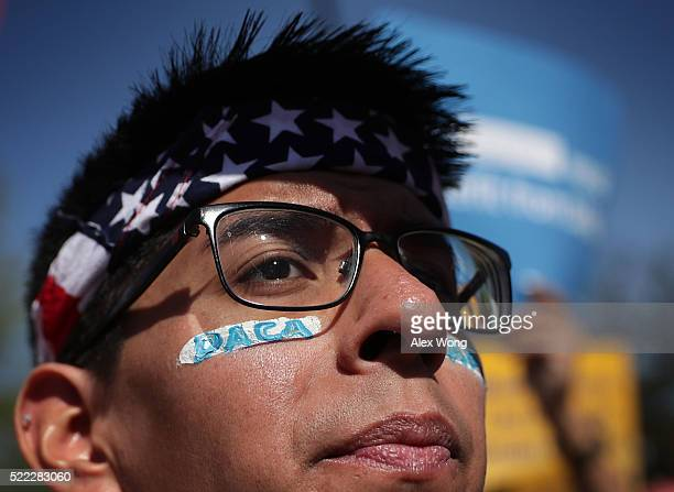 Proimmigration activist Omar Martinez attends a rally in front of the US Supreme Court April 18 2016 in Washington DC The Supreme is scheduled to...