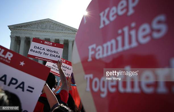 Proimmigration activists gather in front of the US Supreme Court on April 18 2016 in Washington DC The Supreme Court is scheduled to hear oral...