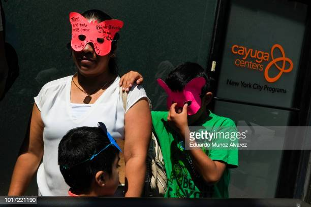 Proimmigration protesters attend a press conference outside of the Cayuga Center on August 15 2018 in New York City Migrant families are demanding...