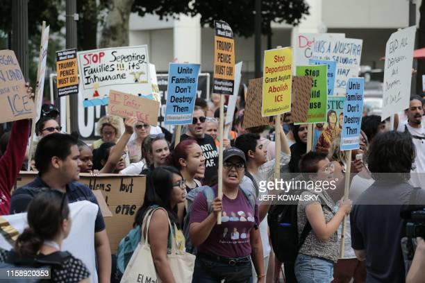 Proimmigration protesters march in Grand Circus Park on July 31 2019 in Detroit Michigan before the second round of the second Democratic primary...